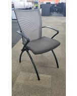 Pre-owned Haworth X99 nesting chair has a Gas (1X-4) seat, Beach mesh back, black fixed avian arms and (4) post legs.