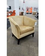 Pre-owned HBF lounge chair has tan corduroy upholstered body with black wood base with (4) feet.