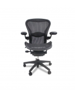 Pre-owned Aeron Work Chair, Size B - Pellicle Classic Seat Back and Seat Pan Mesh, color Carbon (3D01) - Patented Body Conforming Mesh, Breathable - Kinemat Tilt for Natural Pivot of Ankles, Knees and Hips - Adjustable Pneumatic Seat Height - Adjusta