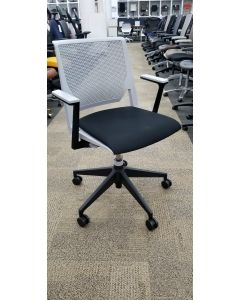 Pre-owned Haworth Very conference chair has grey perforated back and black fabric seat.