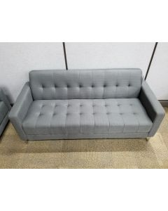New Storlie three-seater sofa with tufted upholstery and metal legs.