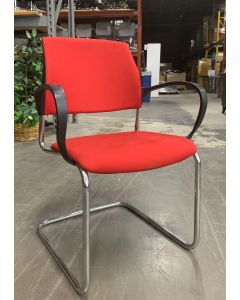 Front view of Pre-owned Drabert side chair has red upholstered body, black loop arms, and (4) chrome post legs. Imported from Germany. -A GRADE-