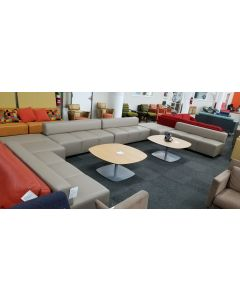 Pre-owned Steelcase Coalesse reception set includes (4) Await three-seat sofas and (2) Await two-section connector benches, both in Dune leatherette upholstery.
