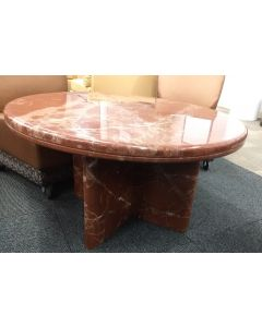 "Pre-owned round coffee table has orange marble surface and matching interlocking X-base. Dimensions: 38""W in diameter x 21""H."