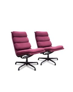 Pair of Herman Miller Eames Aluminum Group executive chairs. Burgundy upholstery. Three cushion seat back. Deep violet frame, no casters. Armless.