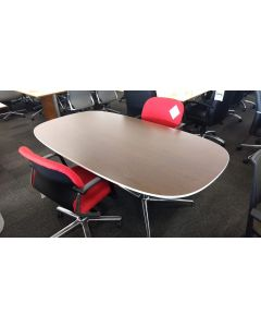 "Pre-owned Steelcase boat-shaped conference table has mahogany laminate top with white edge. Features a conjoined chrome base. Dimensions: 40""D x 72""W. -B GRADE-"